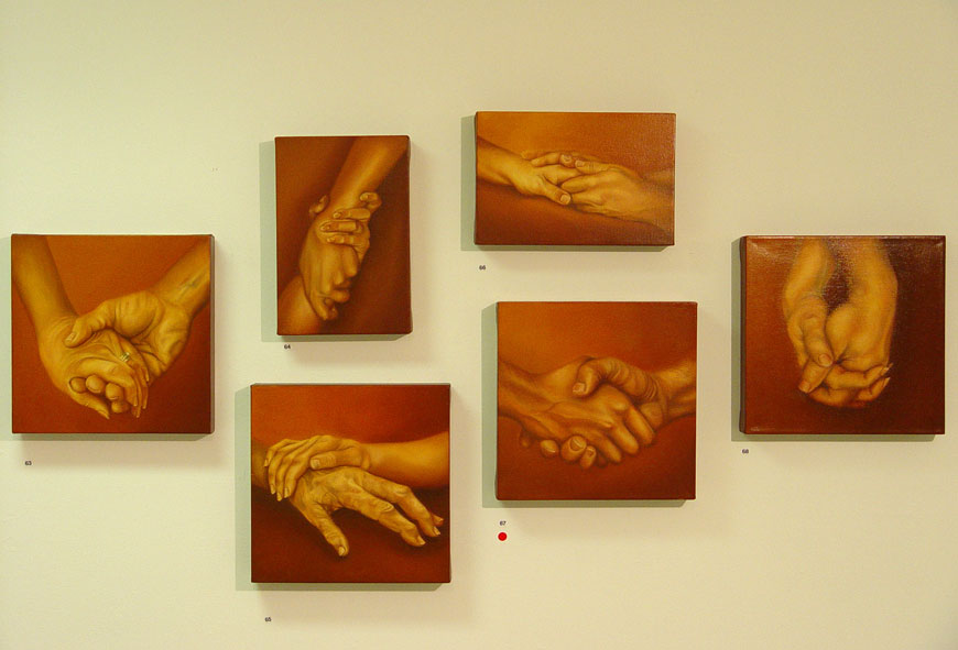 paintings of hands installation